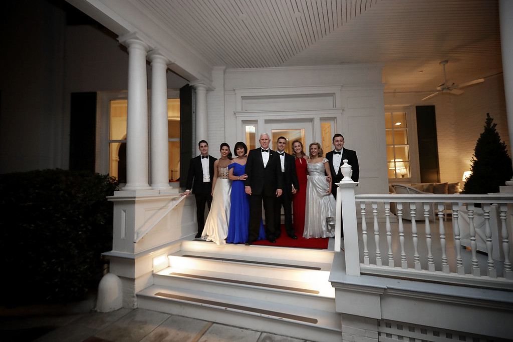 . WASHINGTON, DC - JANUARY 20:  U.S. Vice President Mike Pence (C), his wife Karen Pence, their daughters Audrey (2nd L) and Charlotte (2nd R) and their son Michael and his wife Sarah pose for photographs on the front porch of the vice presidential residence at the U.S Naval Observatory before heading to the inaugural balls January 20, 2017 in Washington, DC. The ball is part of the celebrations following the inauguration of Pence and U.S. President Donald J. Trump.  (Photo by Chip Somodevilla/Getty Images)