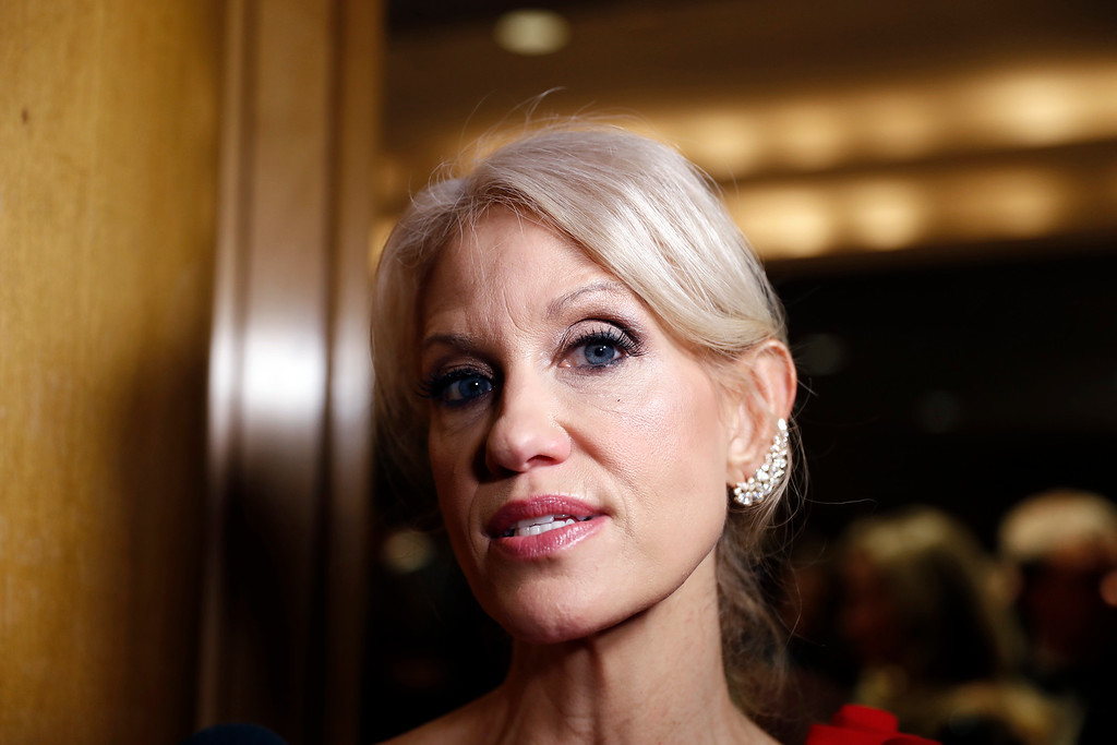 . Trump adviser Kellyanne Conway speaks with reporters at the Indiana Inaugural Ball for Vice president-elect Mike Pence, Thursday, Jan. 19, 2017 in Washington. (AP Photo/Alex Brandon)