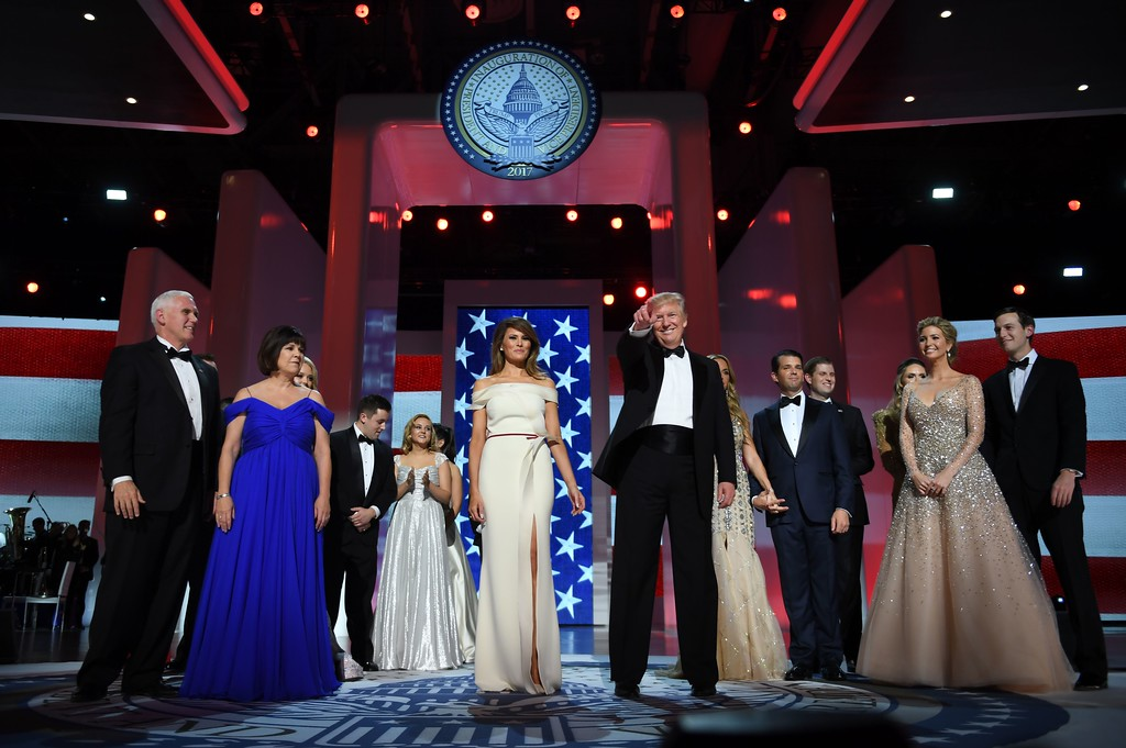 . US President Donald Trump (C) gestures as the first lady Melania Trump (center L), Vice Presidant Mike Pence (L), his wife Karen (2L) and family look on at the Liberty Ball at the Washington DC Convention Center following Donald Trump\'s inauguration as the 45th President of the United States, in Washington, DC, on January 20, 2017.  (JIM WATSON/AFP/Getty Images)