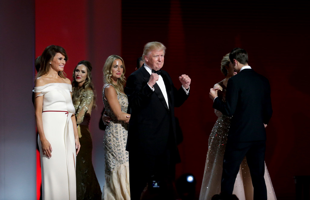 . WASHINGTON, DC - JANUARY 20: President Donald Trump pumps his fist as his family dances at the Liberty Inaugural Ball on January 20, 2017 in Washington, DC.  The Liberty Ball is the first of three inaugural balls that President Donald Trump will be attending.  (Photo by Rob Carr/Getty Images)