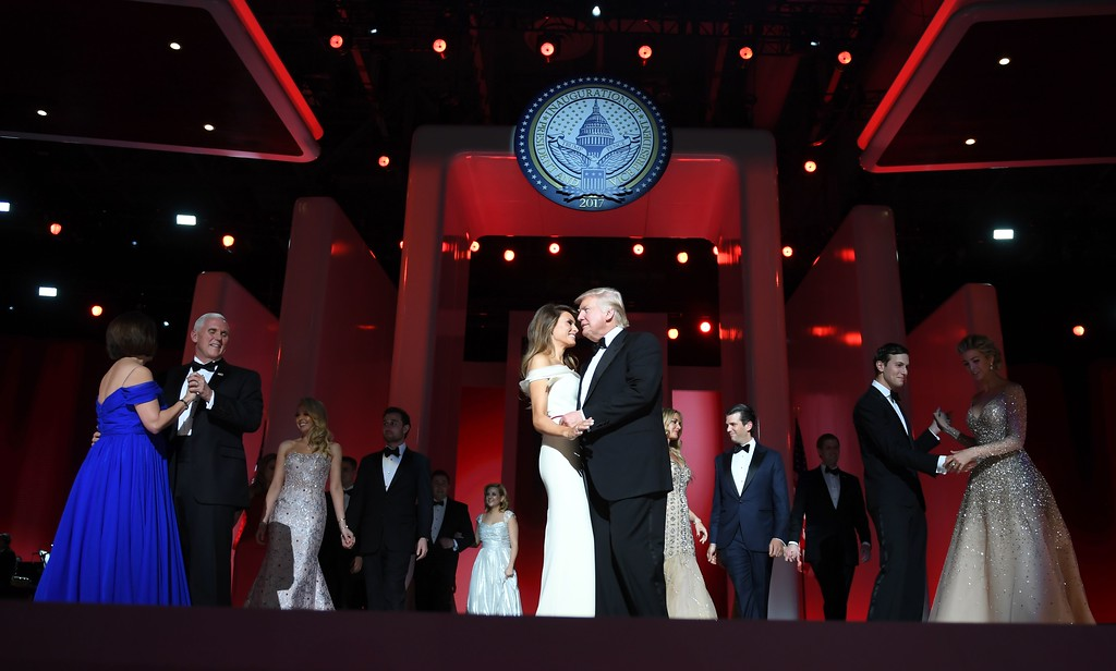 . US President Donald Trump (center R) and the first lady Melania Trump (center L) dance with Vice Presidant Mike Pence (2R), his wife Karen (L) and family  at the Liberty Ball at the Washington DC Convention Center following Donald Trump\'s inauguration as the 45th President of the United States, in Washington, DC, on January 20, 2017.  (JIM WATSON/AFP/Getty Images)