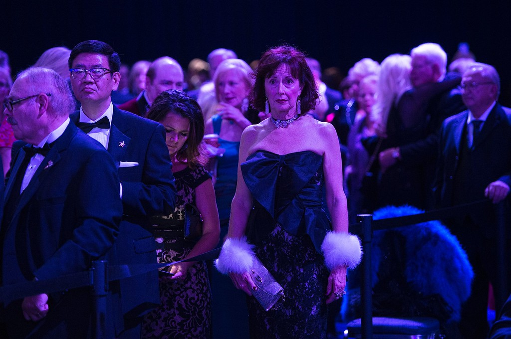 . Guests listen to performers during the Liberty ball at the Walter E. Washington Convention Center following Donald Trump\'s inauguration as the 45th President of the United States, in Washington, DC, on January 20, 2017. / AFP / Brendan Smialowski        (Photo credit should read BRENDAN SMIALOWSKI/AFP/Getty Images)