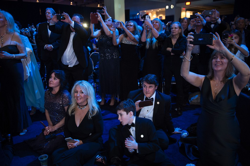 . Guests listen to President Donal Trump speech during the Liberty ball at the Walter E. Washington Convention Center following Donald Trump\'s inauguration as the 45th President of the United States, in Washington, DC, on January 20, 2017. / AFP / Brendan Smialowski        (Photo credit should read BRENDAN SMIALOWSKI/AFP/Getty Images)