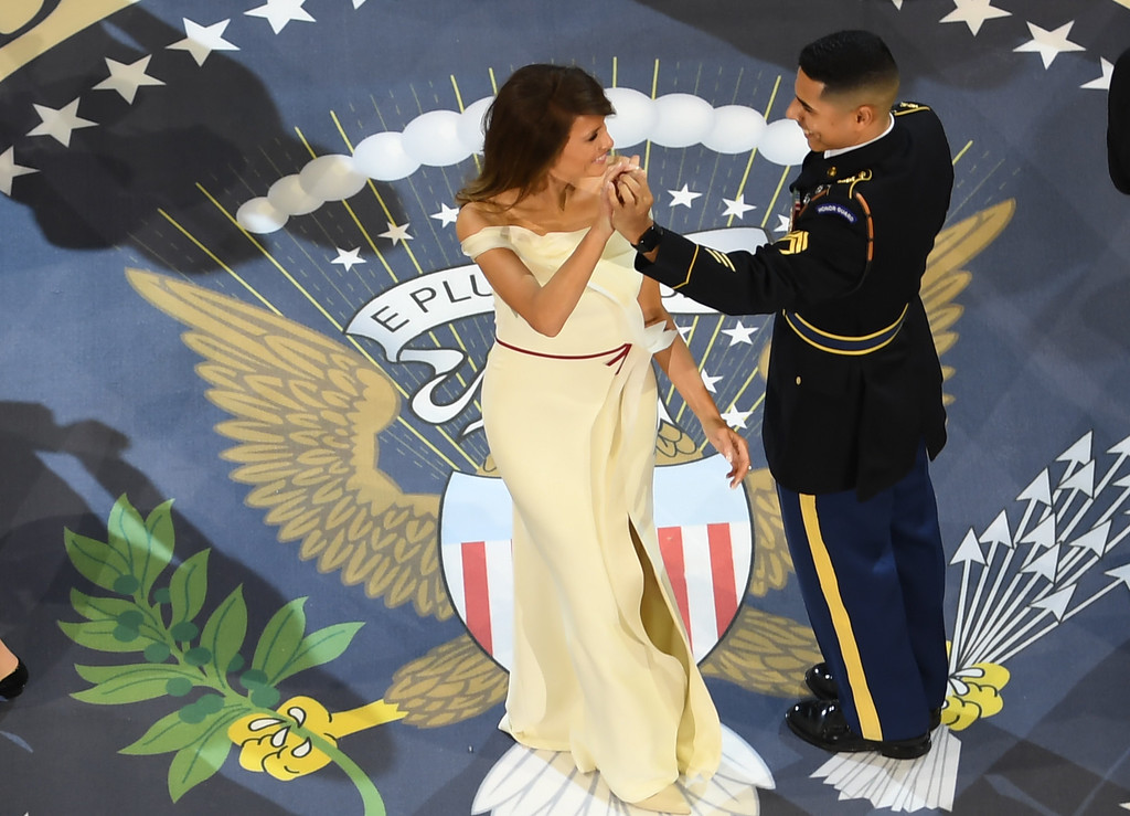 . First lady Melania Trump dances with a service member at the Armed Services ball at the National Building museum following Donald Trump\'s inauguration as the 45th President of the United States, in Washington, DC, on January 20, 2017.  (JIM WATSON/AFP/Getty Images)