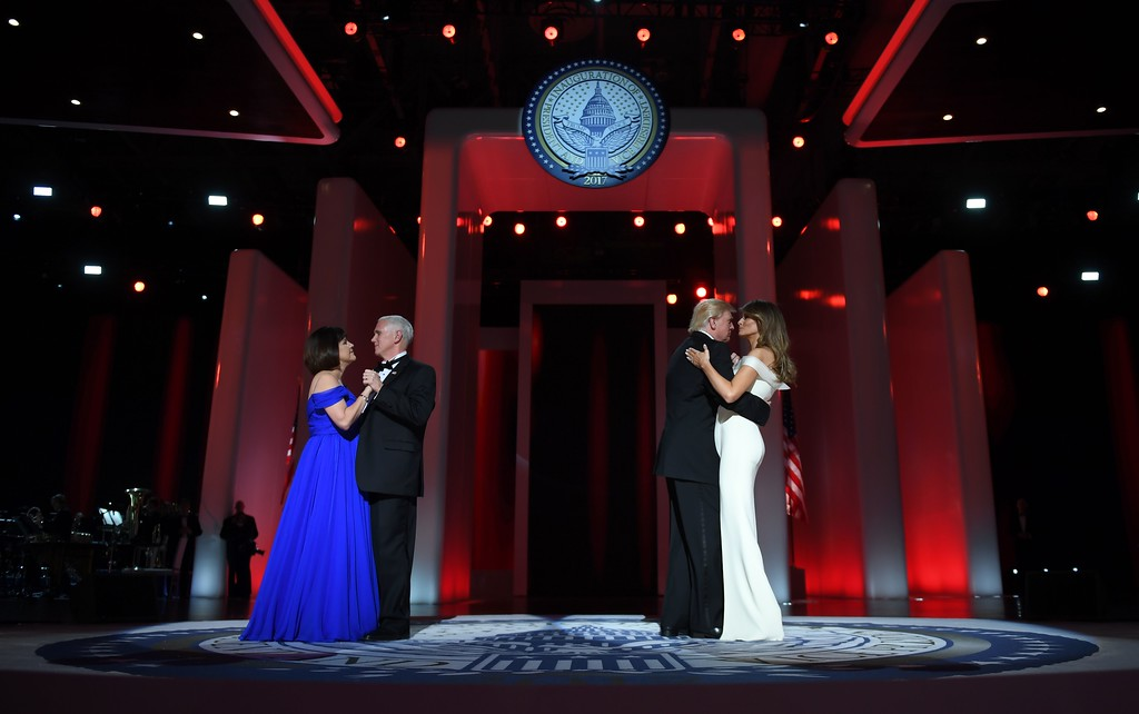 . US President Donald Trump (2R) and the first lady Melania Trump (R) dance with Vice Presidant Mike Pence and his wife Karen at the Liberty Ball at the Washington DC Convention Center following Donald Trump\'s inauguration as the 45th President of the United States, in Washington, DC, on January 20, 2017.  (JIM WATSON/AFP/Getty Images)