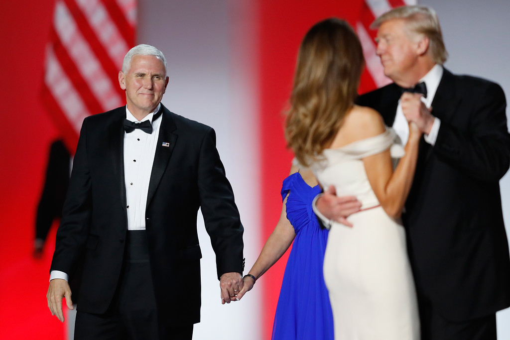 . WASHINGTON, DC - JANUARY 20: Vice President Mike Pence (L) looks on as President Donald Trump and first lady Melania Trump dance at the Freedom Inaugural Ball at the Washington Convention Center January 20, 2017 in Washington, D.C.  President Trump was sworn today as the 45th U.S. President.  (Photo by Aaron P. Bernstein/Getty Images)