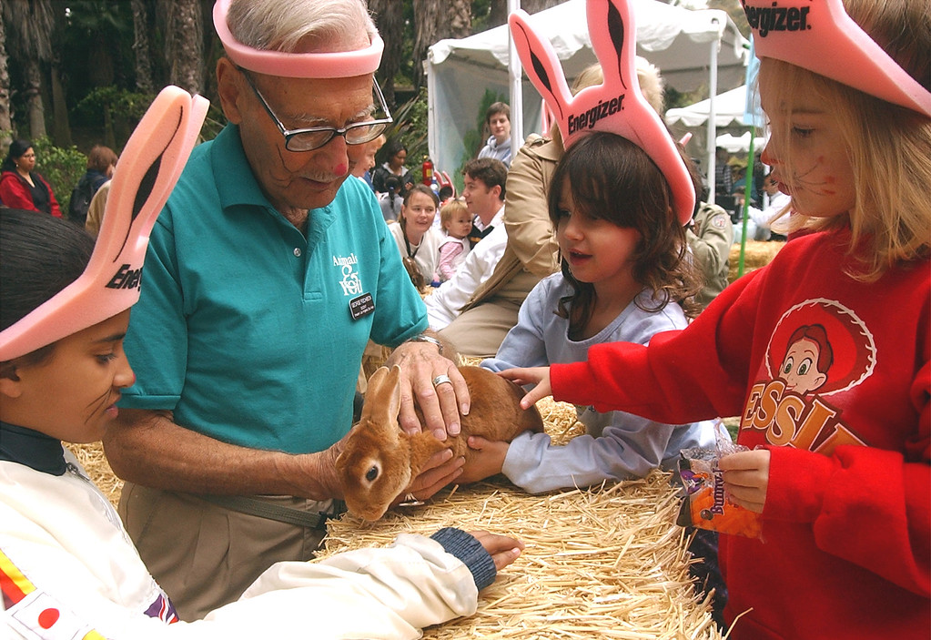 . Longtime TV personality Dr. George Fischbeck introduces children to a pet rabbit on Friday, March 29, 2002, at the Los Angeles Zoo\'s Big Bunny spring festival. (Gene Blevins/Los Angeles Daily News)