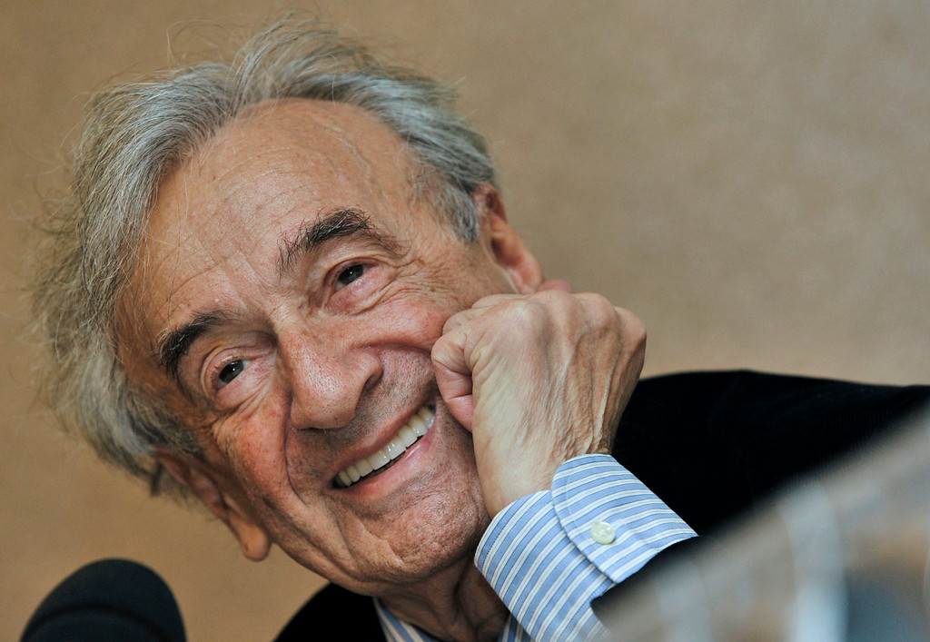 . FILE - In this Dec. 10, 2009 file photo, Elie Wiesel smiles during a news conference in Budapest, Hungary. Wiesel, the Nobel laureate and Holocaust survivor has died.  His death was announced Saturday, July 2, 2016  by Israel\'s Yad Vashem Holocaust Memorial.  (AP Photo/Bela Szandelszky, file)
