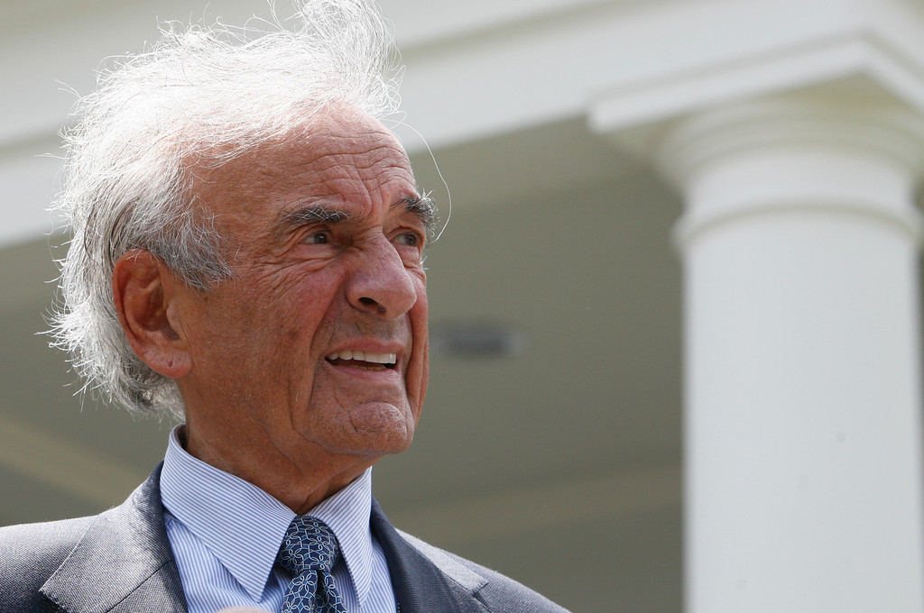 . Nobel Peace Prize laureate Elie Wiesel talks to reporters after having a private lunch with President Barack Obama at the White House in Washington, Tuesday, May 4, 2010. (AP Photo/Charles Dharapak)