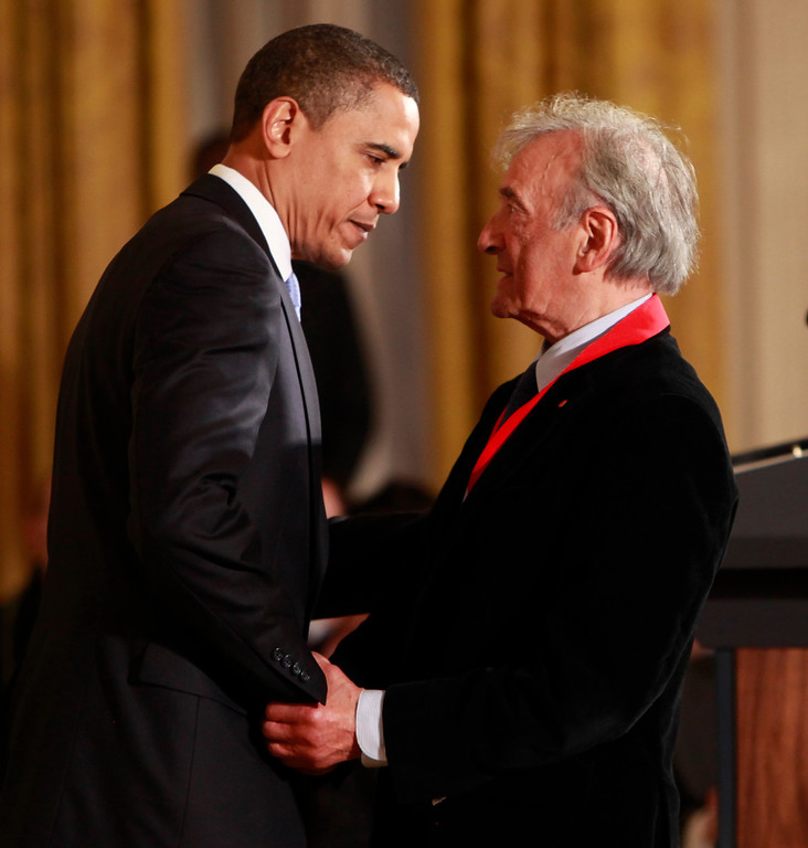 . President Barack Obama presents the 2009 National Humanities Medal to Elie Wiesel, Thursday, Feb. 25, 2010, in the East Room of the White House in Washington. (AP Photo/Pablo Martinez Monsivais)