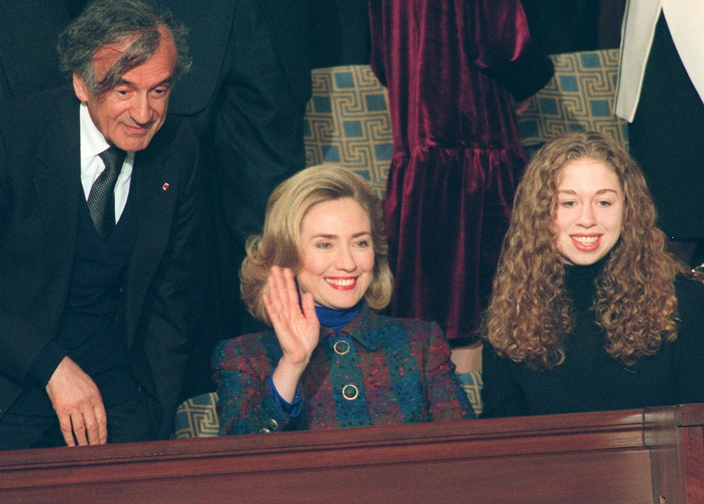 . First lady Hillary Rodham Clinton, daughter Chelsea and Nobel Prize winner Elie Wiesel look on as President Clinton arrives in the House Chamber on Capitol Hill Tuesday Jan. 23, 1996 to deliver his State of the Union address. (AP Photo/Greg Gibson)