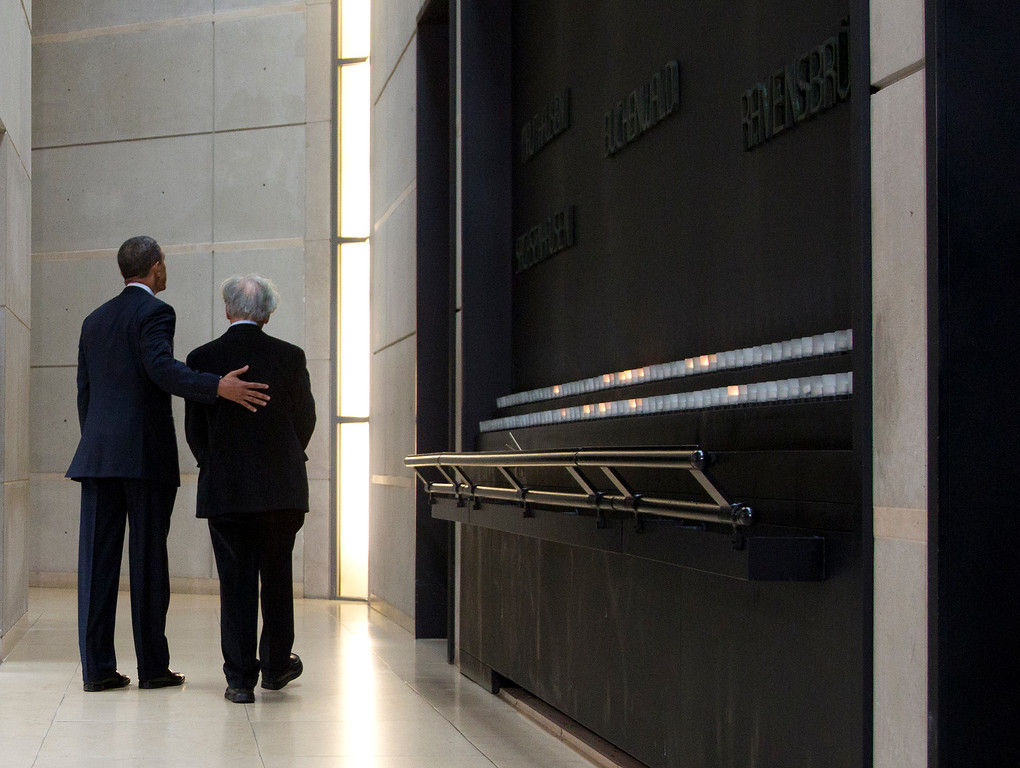 . President Barack Obama, left, and Nobel Peace Prize laureate and Holocaust survivor Elie Wiesel, right, turn to leave after lighting candles in the Hall of Remembrance as they tours the Holocaust Memorial Museum, Monday, April 23, 2012, in Washington. (AP Photo/Carolyn Kaster)