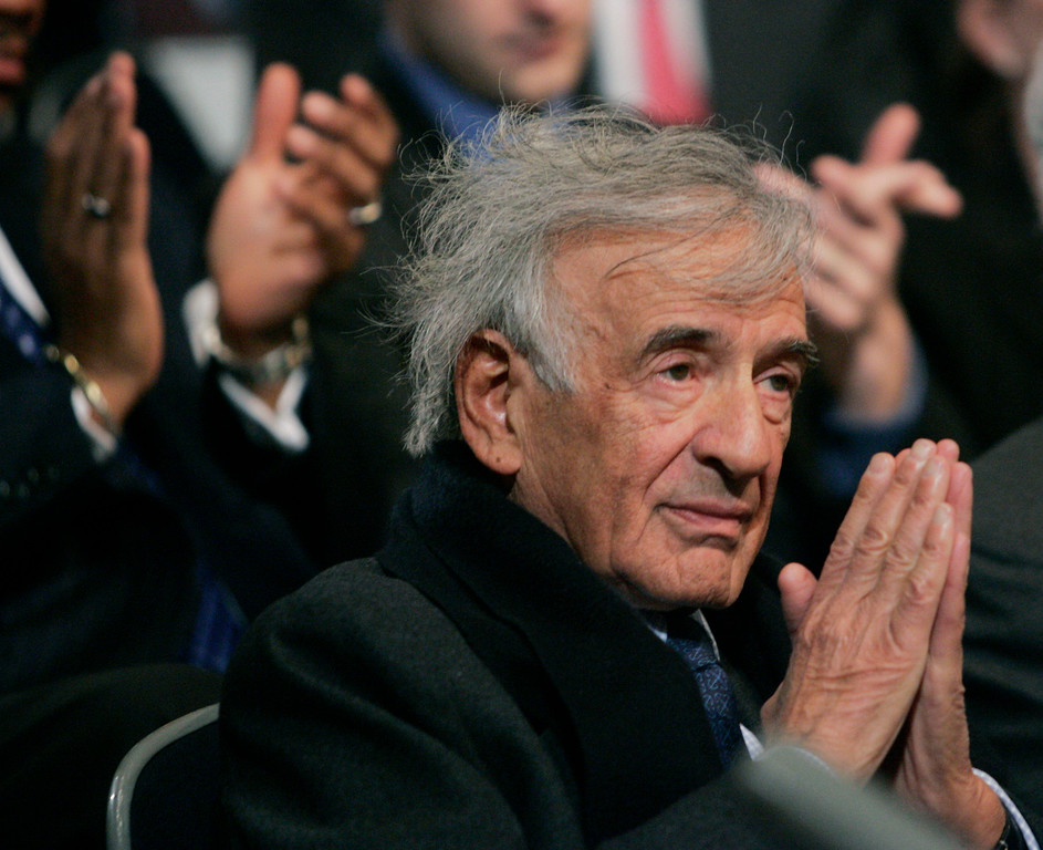 . Novelist and Nobel Peace Prize recipient Elie Wiesel, puts his hands together as he receives applause after being acknowledged by President Bush, Wednesday, April 18, 2007, at a U.S. Holocaust Museum in Washington. (AP Photo/Pablo Martinez Monsivais)