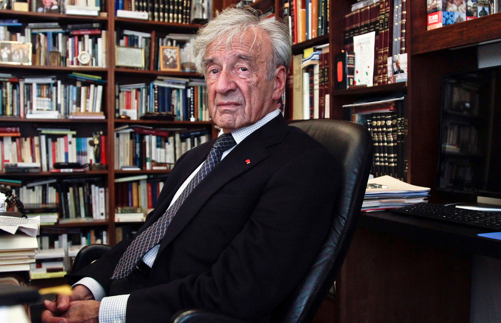 """. This Sept. 12, 2012, photo shows Holocaust activist and Nobel Peace Prize recipient Elie Wiesel, 83, in his office in New York.  Weisel\'s latest book is titled, \""""Open Heart.\""""  (AP Photo/Bebeto Matthews)"""