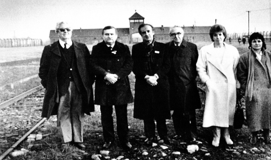 . Five Nobel Prize laureates gather on the railroad track leading into the former Birkanau concentration camp on Jan. 18, 1988 in Oswiecim, Poland, from let: Daniel Bovet, of Belgium who won the prize for medicine in 1957; Lech Walessa, of Poland, 1983 winner of the peace prize; Elie Wiesel, of the United States, 1986 winner of the peace prize; Egil Aarvik, president of the Norwegian Nobel Committee; Mairead Corrigan McGuire and Betty Williams Perkins, of Northern Ireland, co-winners of the peace prize in 1976. (AP Photo/Sokolowski)