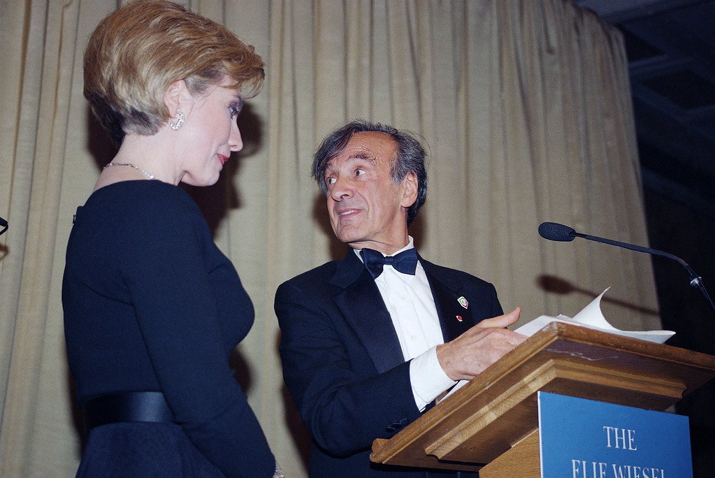 . First Lady Hillary Rodham Clinton, left and Elie Wiesel stand at the podium as she accepts the Humanitarian Award from the Elie Wiesel Foundation at the New York Public Library Thursday, April 14, 1994. (AP Photo/Kevin Larkin)