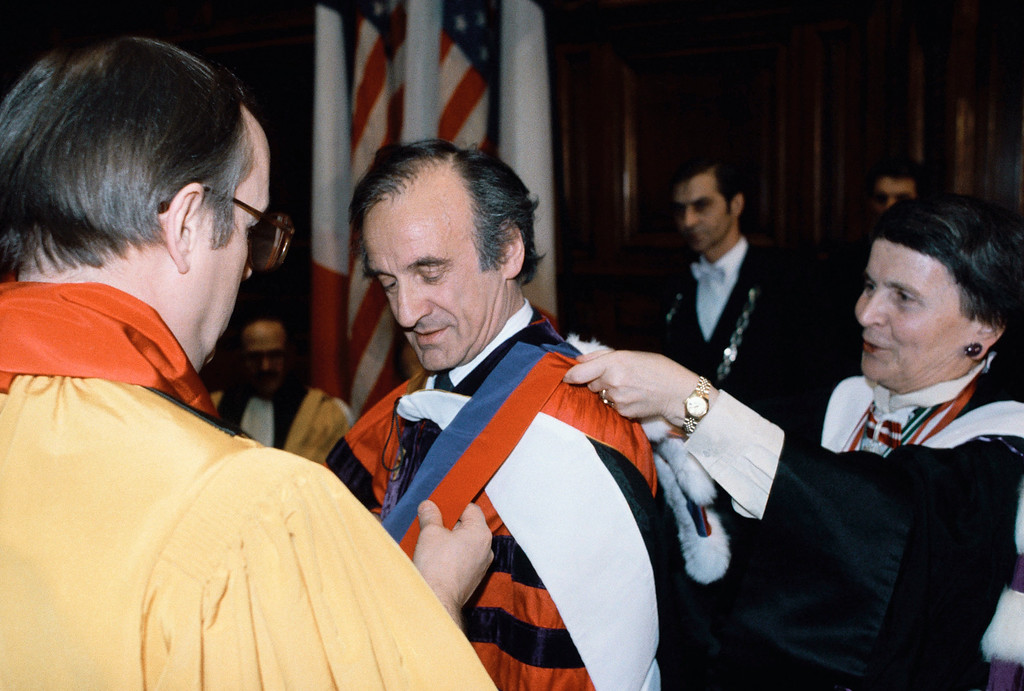. 1986 Nobel Peace Prize winning writer Elie Wiesel, is awarded the rank of Doctor Honoris Causa of Paris Sorbonne University by Director of Education Helene Ahrweiller, right, while Chairman of the Sorbonne Jacques Soppelsa looks, Feb. 26, 1987, during a ceremony at the Sorbonne University in Paris. (AP Photo/Lionel Cironneau)