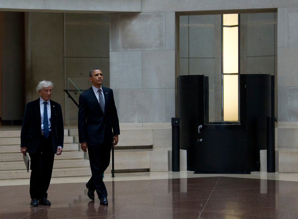 . President Barack Obama, right, and Nobel Peace Prize laureate and Holocaust survivor Elie Wiesel, left, enter the Hall of Remembrance as they tour the Holocaust Memorial Museum, Monday, April 23, 2012, in Washington. (AP Photo/Carolyn Kaster)