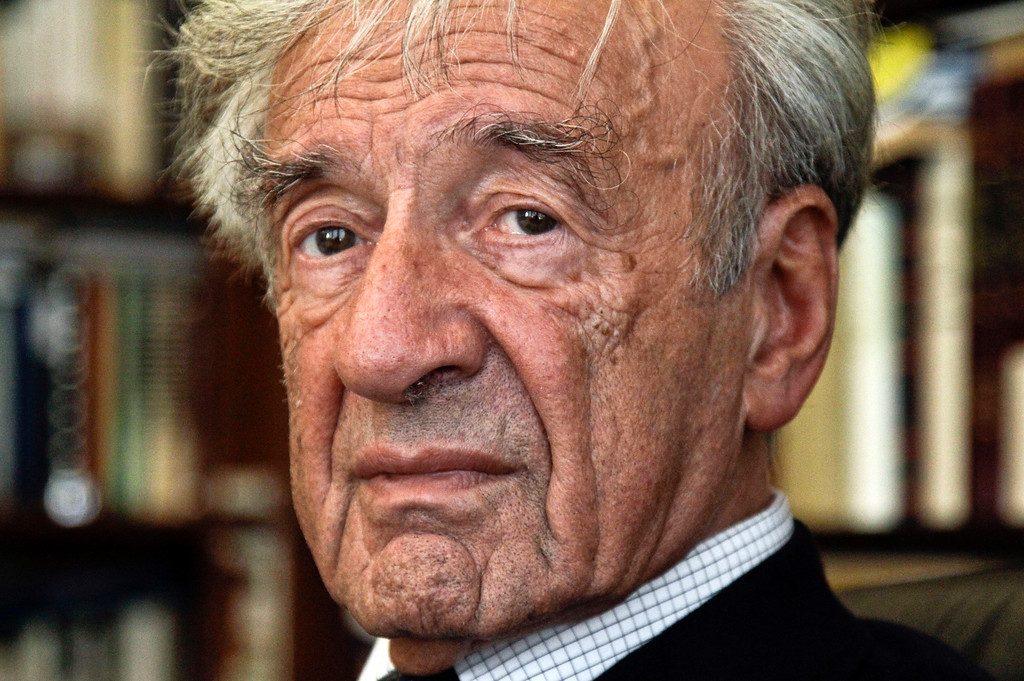 . FILE - In this Sept. 12, 2012, photo  Elie Wiesel is photographed in his office in New York.  Israel\'s Yad Vashem Holocaust Memorial says Elie Wiesel has died at 87. (AP Photo/Bebeto Matthews)
