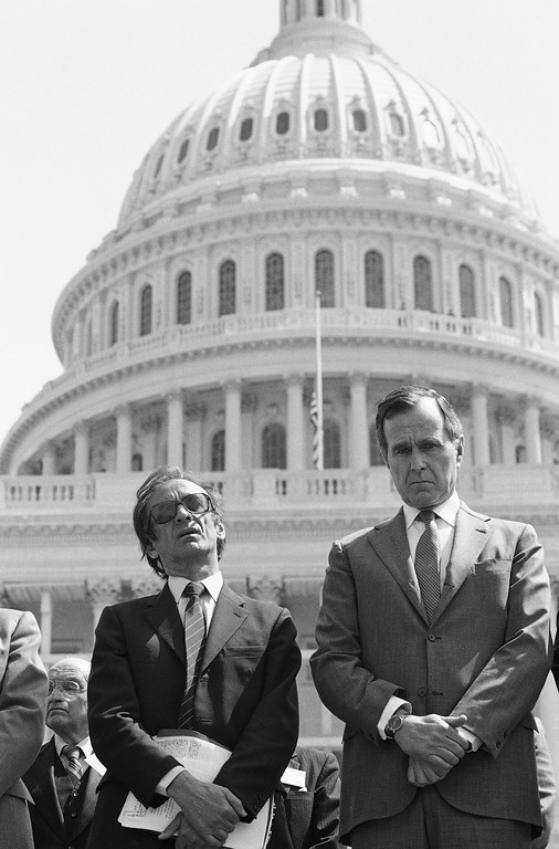 . Vice President George H.W. Bush, right, and Elie Wiesel, chairman of the U.S. Holocaust Memorial Council take part in a Capitol Hill Congressional ceremony on Wednesday, April 13, 1983 as part of the American Gathering of Jewish Holocaust Survivors. (AP Photo/ Ira Schwarz)