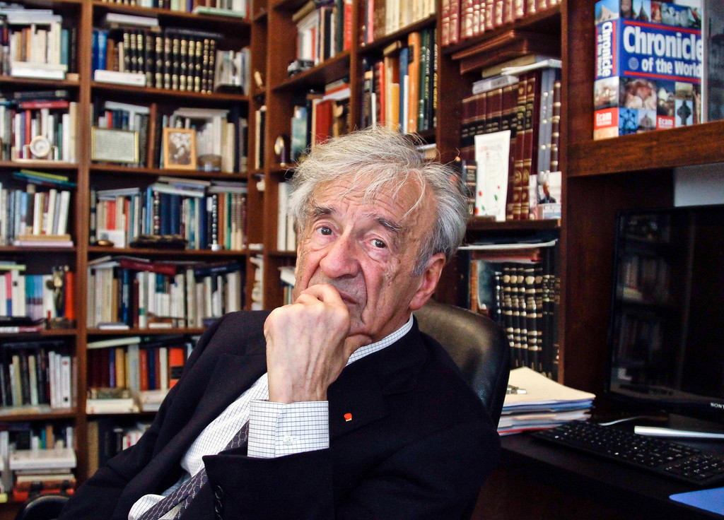 . FILE - In this Sept. 12, 2012,  photo Elie Wiesel is photographed in his office in New York.  Wiesel, the Nobel laureate and Holocaust survivor has died.  His death was announced Saturday, July 2, 2016  by Israel\'s Yad Vashem Holocaust Memorial.  (AP Photo/Bebeto Matthews)