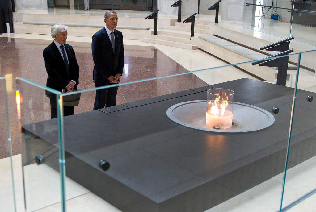 . President Barack Obama and Nobel Peace Prize laureate and Holocaust survivor Elie Wiesel stop for a moment of silence in the Hall of Remembrance as they toured the Holocaust Memorial Museum in Washington, Monday, April 23, 2012.Wiesel, the Nobel laureate and Holocaust survivor has died.  His death was announced Saturday, July 2, 2016  by Israel\'s Yad Vashem Holocaust Memorial. (AP Photo/Carolyn Kaster)