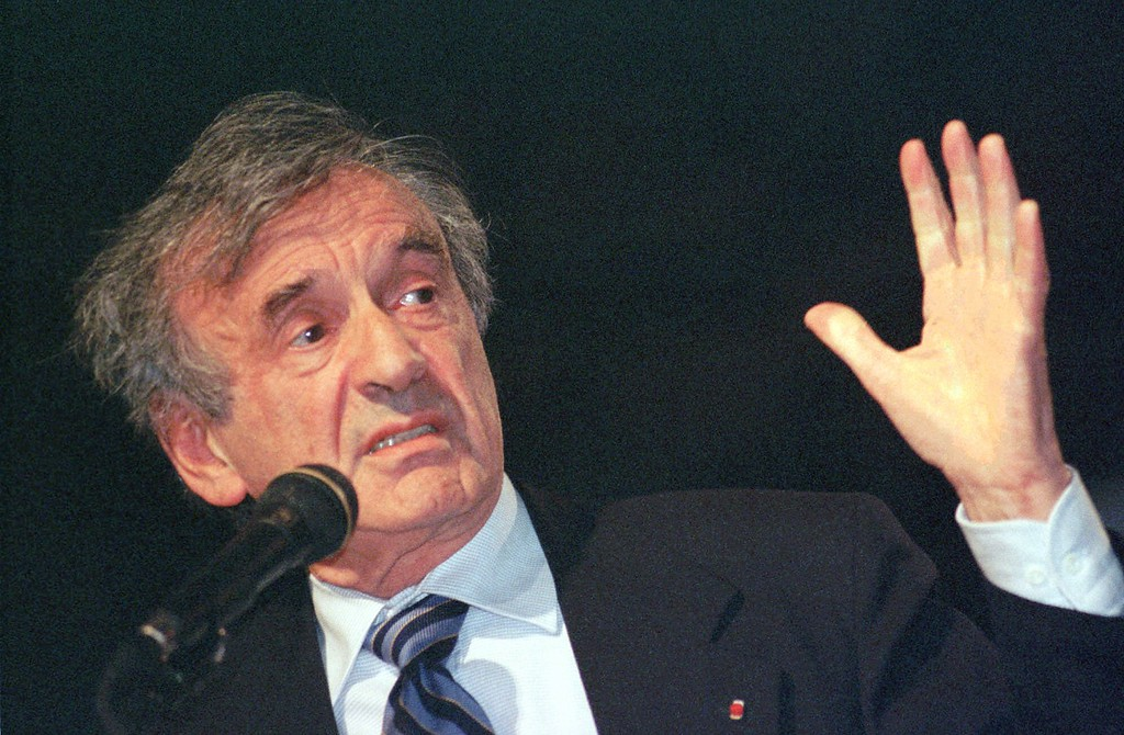 . Elie Wiesel speaks at a symposium at Boston University being   held in honor of his life and work, Sunday, Oct. 25, 1998 in Boston. The three-day symposium celebrated Wiesel\'s 70th birthday.  (AP Photo/Patricia McDonnell)