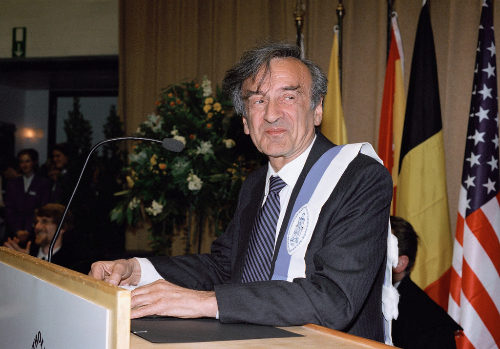 . French philosopher Elie Wiesel, witness of the holocaust and 1986 Nobel Peace Prize laureate, speaks after receiving the Doctor Honoris Causa Insignia from the Catholic University of Louvain-la-Neuve in Louvain-la-Neuve, Belgium, Feb. 2, 1995. (AP Photo/Jacques Collet)