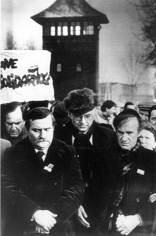 . Nobel Peace Prize winners Lech Walesa, left, and american Jewish writer Elie Wiesel, right, arrive at the former Auschwitz-Birkenau death camp in Poland on Sunday, Jan. 17, 1988. Wiesel was a prisoner 43 years ago. (AP Photo/Sokolowski)