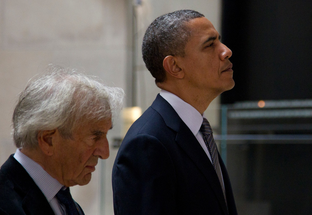 . President Barack Obama, left, and Nobel Peace Prize laureate and Holocaust survivor Elie Wiesel stop for a moment of silence in the Hall of Remembrance as they tours the Holocaust Memorial Museum, Monday, April 23, 2012, in Washington. (AP Photo/Carolyn Kaster)