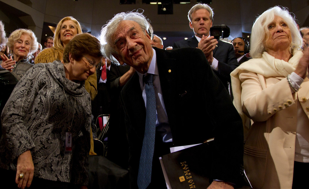 . Nobel Peace Prize laureate and Holocaust survivor Elie Wiesel, center looks tot he stage and President Barack Obama, not seen, as he takes his seat at the Holocaust Memorial Museum, Monday, April 23, 2012, in Washington. (AP Photo/Carolyn Kaster)