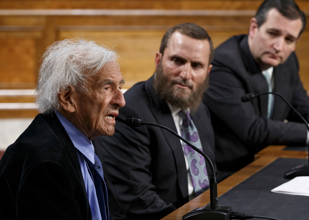 . From left, Nobel Peace Prize laureate Elie Wiesel, a survivor of the Holocaust, Rabbi Shmuley Boteach, and Sen. Ted Cruz, R-Texas, participate in a dialogue on keeping Iran from having nuclear weapons, hosted by a group fighting discrimination against Jews, Monday, March 2, 2015, on Capitol Hill in Washington. (AP Photo/J. Scott Applewhite)
