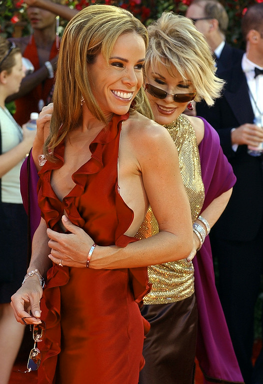 . Red carpet fashion commentator Joan Rivers, rear, checks out her daughter Melissa\'s outfit as they arrive for the 54th Annual Primetime Emmy Awards Sunday, Sept. 22, 2002, at the Shrine Auditorium in Los Angeles. (AP Photo/Laura Rauch)