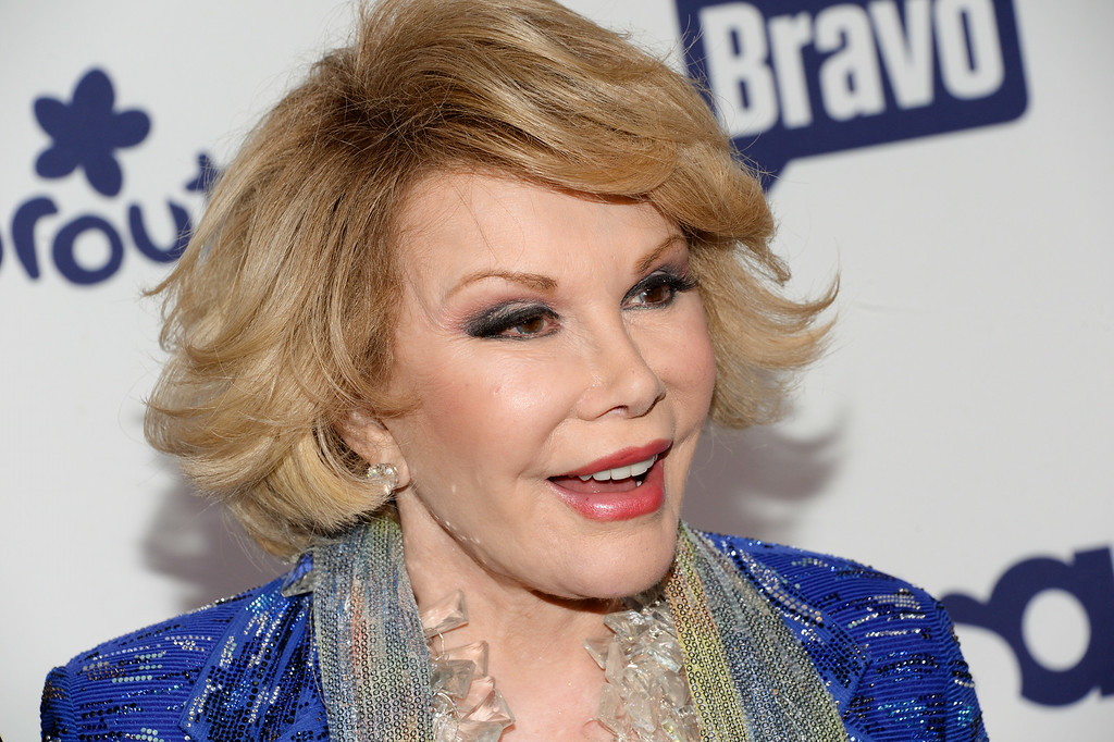 . File - Joan Rivers attends the NBCUniversal Cable Entertainment 2014 Upfront at the Javits Center on Thursday, May 15, 2014, in New York. Rivers, the groundbreaking comedian who built a six-decade career on her relentless barbed humor, died Thursday, September 4, 2014. Rivers had been rushed to Mount Sinai Hospital in New York City on Aug. 28, 2014 after going into cardiac arrest while undergoing an outpatient procedure.  (Photo by Evan Agostini/Invision/AP)