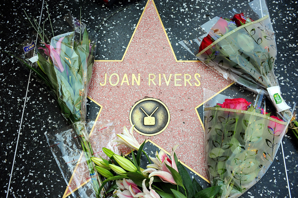 . Flowers are placed around Joan Rivers star on the Hollywood Walk of Fame after her passing Thursday, September 4, 2014. (Andy Holzman/Los Angeles Daily News)