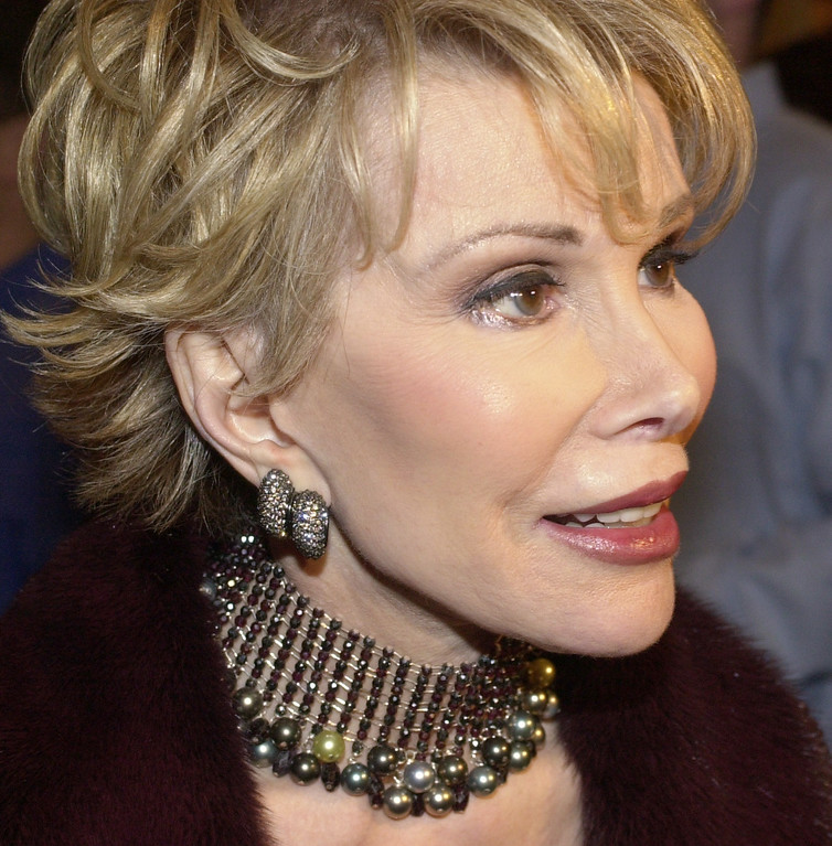. Joan Rivers arrives for a tribute for New York Mayor Rudolph Giuliani Wednesday, Nov. 14, 2001 at the Sheraton New York Hotel. The proceeds from the benefit go to the Twin Towers Fund and the Forum\'s Children Foundation. (AP Photo/Mark Lennihan)