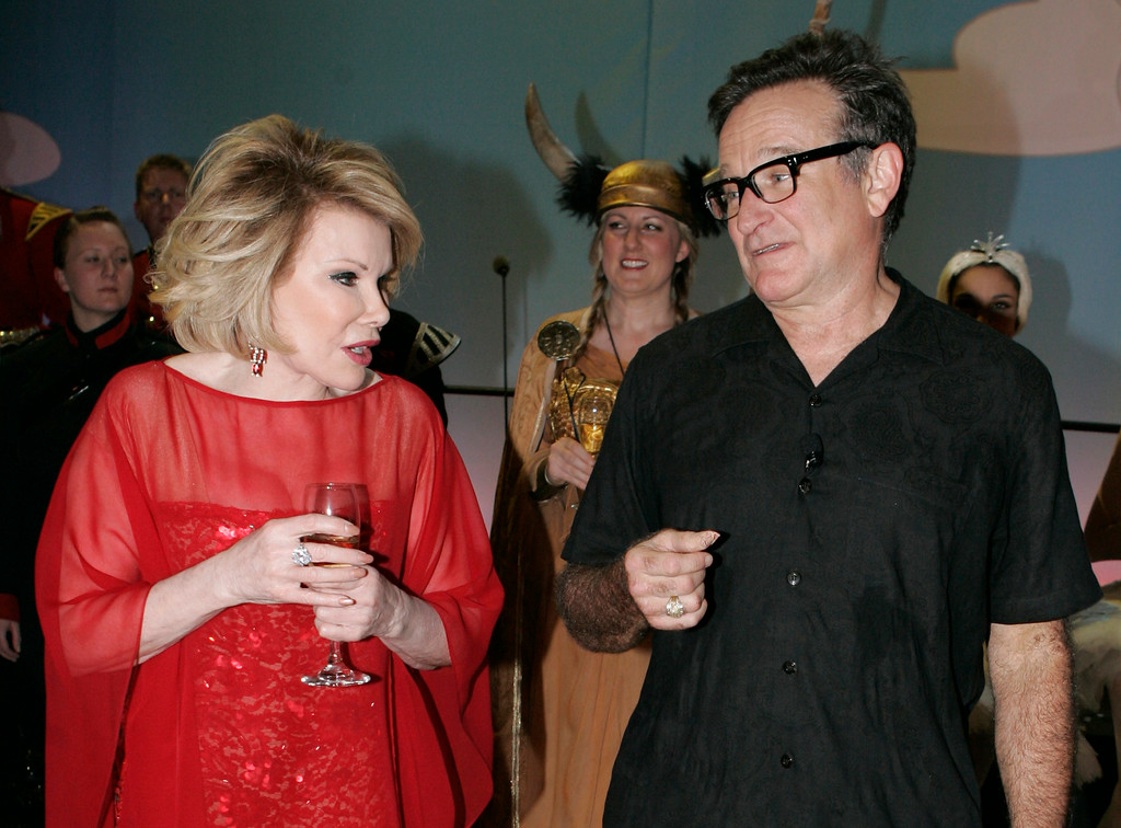 . US actors and comedians Joan Rivers and Robin Williams  backstage at the Wimbledon Theatre after a charity performance in aid of the Prince\'s Trust charity, in London, Wednesday, Nov. 12, 2008.The event is one of a number to celebrate the Prince\'s 60th birthday on Nov. 14.  Both Williams and Rivers took part in the show. (AP Photo/Alastair Grant POOL)