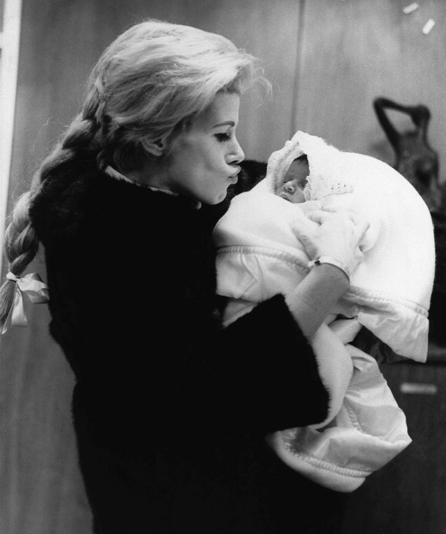 . Comedienne Joan Rivers with daughter Melissa as they leave Lenox Hill Hospital, Jan. 1968, where the baby, Joan\'s first, was born on January 20. Father is TV producer Edgar Rosenberg. (AP Photo)