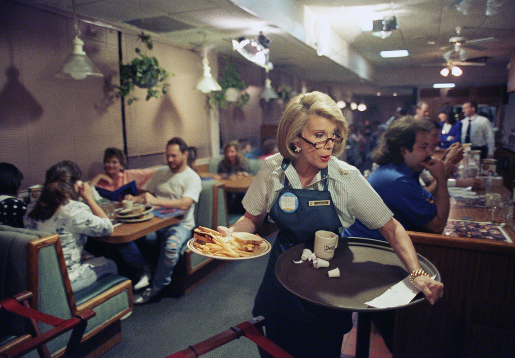 . File - Talk show host Joan Rivers works a job as a waitress at a Denny\'s restaurant in West Palm Beach, Fla., Feb. 21, 1992. Rivers switched jobs with Rhonda Denton who works at the restaurant and who will take over River\'s job in New York on a program which will air on March 4. (AP Photo/Ray Fairall)