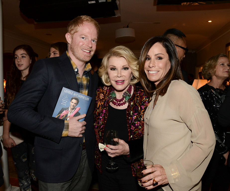 ". Television personality Melissa Rivers, right, actor Jesse Tyler Ferguson, left, and comedian Joan Rivers at the ""Glamorous By George\"" book launch hosted by Joan and Melissa Rivers on Monday, Jan. 13, 2014 in Los Angeles. (Photo by Dan Steinberg/Invision/AP)"