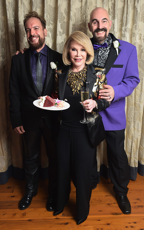 ". TV personality Joan Rivers officiates the gay wedding of William ""Jed\"" Ryan (L) and Joseph Aiello at the Plaza Athenee on August 15, 2014 in New York City.  (Photo by Michael Loccisano/Getty Images)"