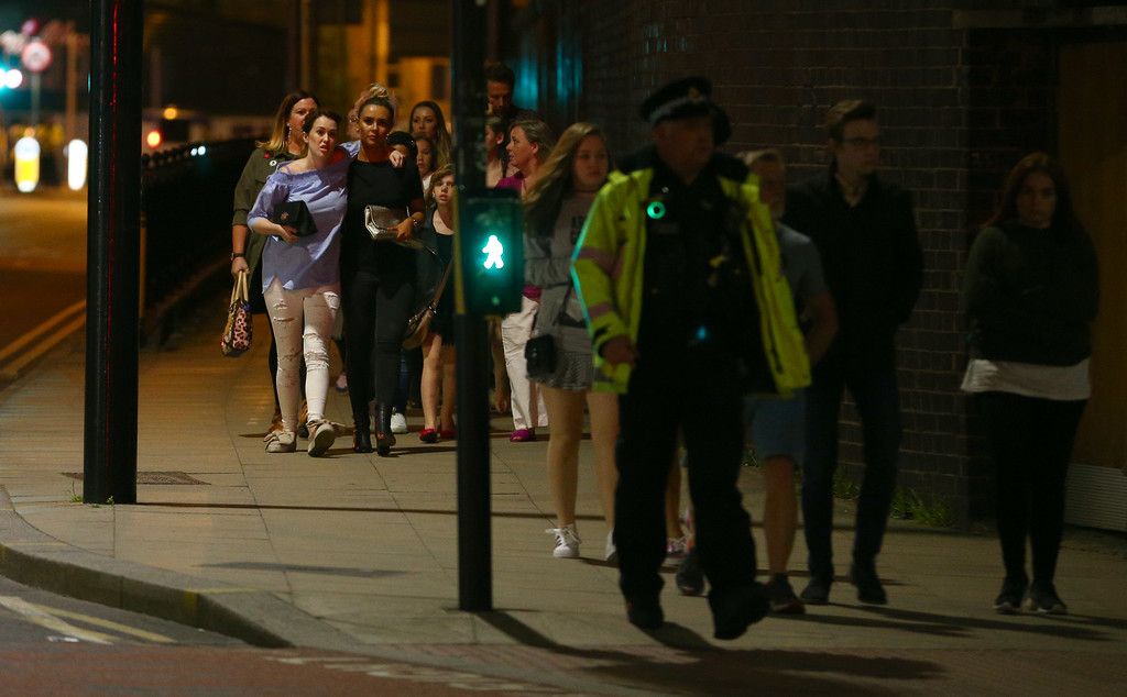 . MANCHESTER, ENGLAND - MAY 23: Members of the public are escorted from the Manchester Arena on May 23, 2017 in Manchester, England.  There have been reports of explosions at Manchester Arena where Ariana Grande had performed this evening.  Greater Manchester Police have have confirmed there are fatalities and warned people to stay away from the area. (Photo by Dave Thompson/Getty Images)