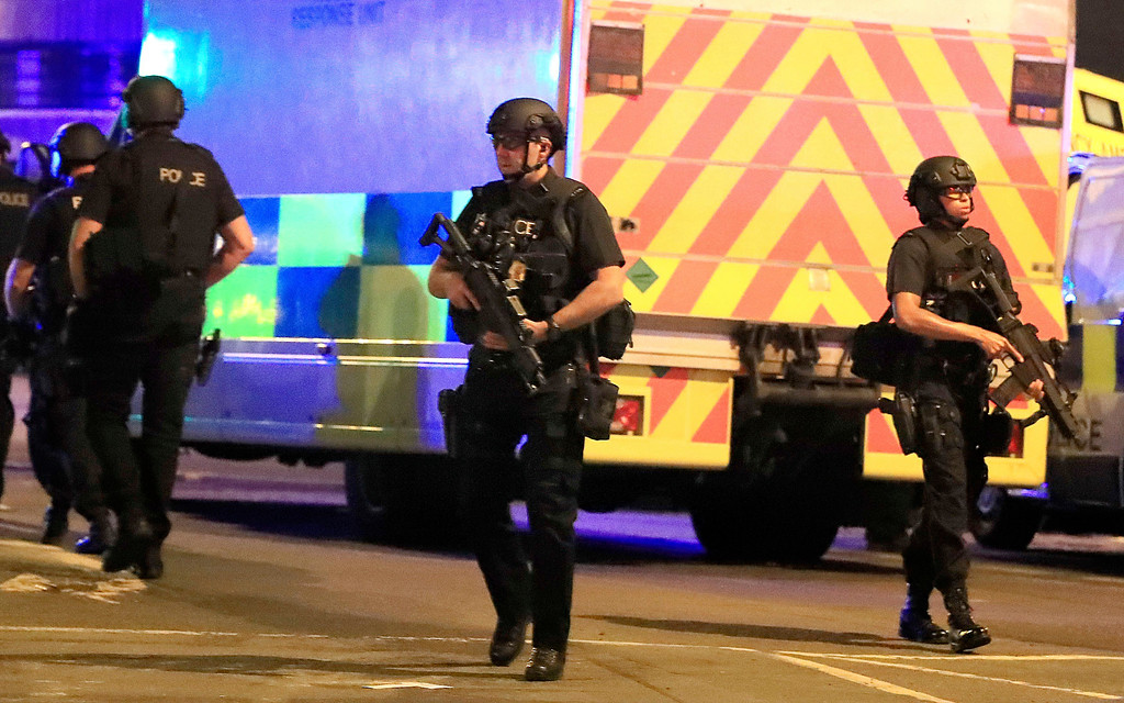 . Armed police respond after reports of an explosion at Manchester Arena during an Ariana Grande concert in Manchester, England, Monday, May 22, 2017. Several people have died following reports of an explosion Monday night at the concert in northern England, police said. A representative said the singer was not injured. (Peter Byrne/PA via AP)