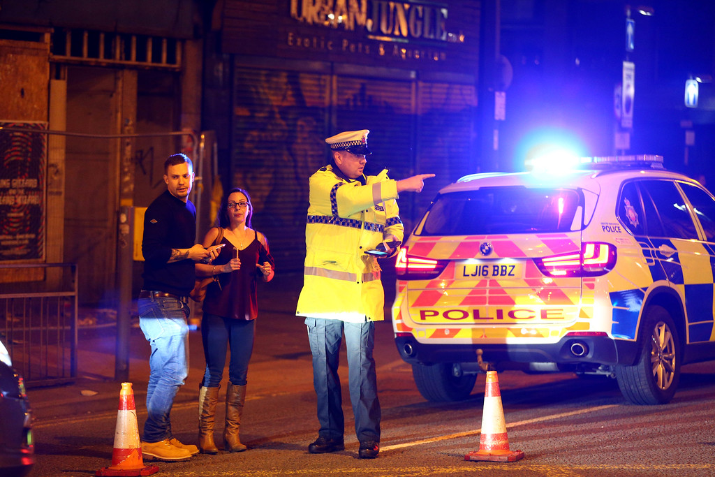 . MANCHESTER, ENGLAND - Police stand by a cordoned off street close to the Manchester Arena on May 22, 2017 in Manchester, England.  There have been reports of explosions at Manchester Arena where Ariana Grande had performed this evening.  Greater Manchester Police have have confirmed there are fatalities and warned people to stay away from the area. (Photo by Dave Thompson/Getty Images)