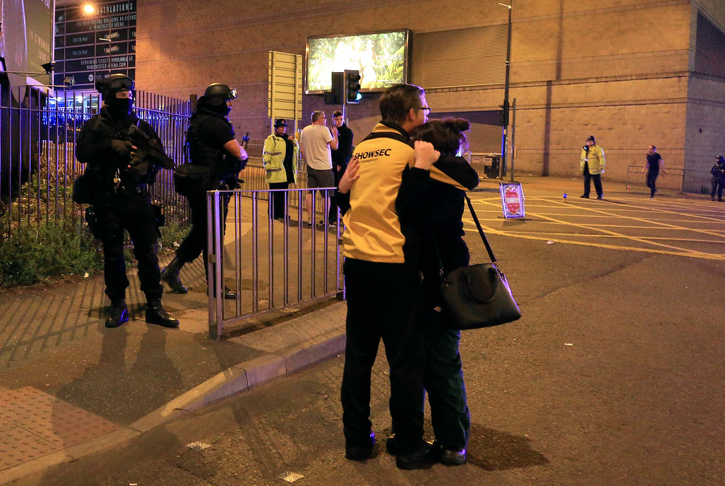 ". Armed police stand guard at Manchester Arena after reports of an explosion at the venue during an Ariana Grande gig  in Manchester, England Monday, May 22, 2017. Police says there are ""a number of fatalities\"" after reports of an explosion at an Ariana Grande concert in northern England. (Peter Byrne/PA via AP)"