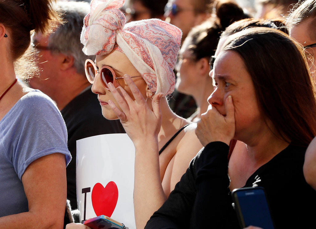 . People attend a vigil in Albert Square, Manchester, England, Tuesday May 23, 2017, the day after the suicide attack at an Ariana Grande concert that left 22 people dead as it ended on Monday night. (AP Photo/Kirsty Wigglesworth)