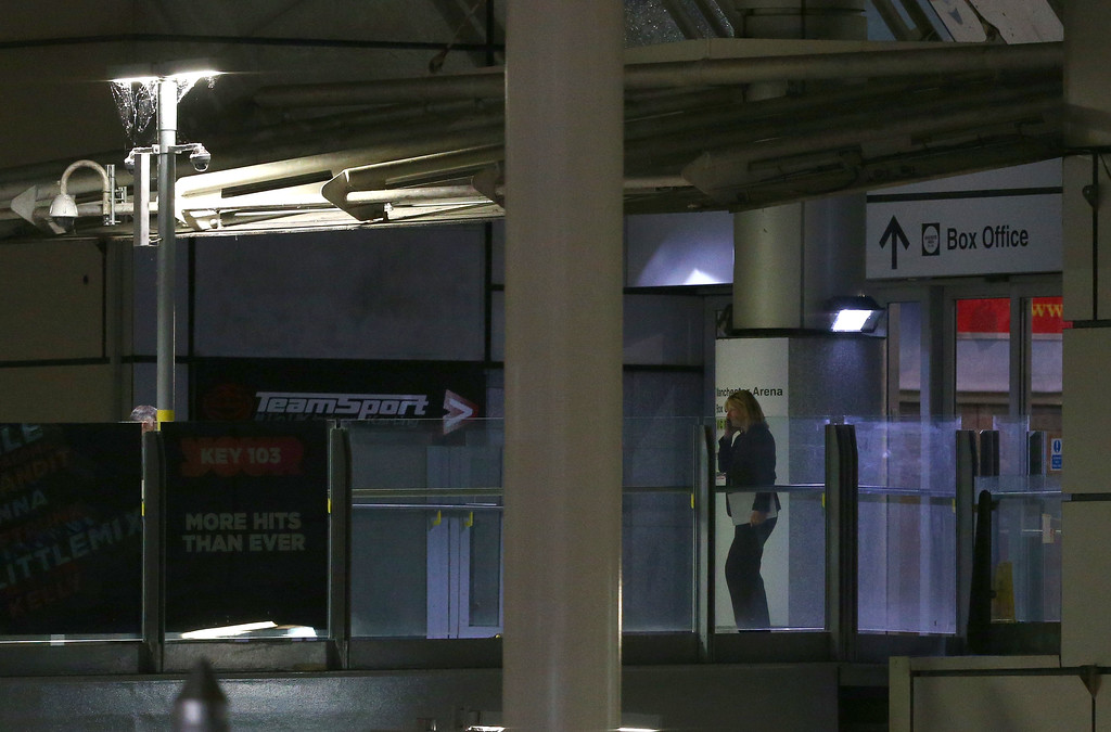 . MANCHESTER, ENGLAND - MAY 23: A possible Police Investigator exits the Box Office entrance to the Manchester Arena on May 23, 2017 in Manchester, England.  There have been reports of explosions at Manchester Arena where Ariana Grande had performed this evening.  Greater Manchester Police have have confirmed there are fatalities and warned people to stay away from the area. (Photo by Dave Thompson/Getty Images)