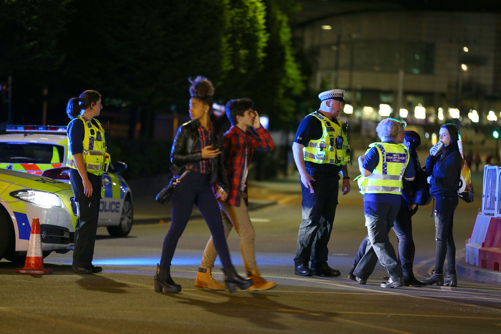 . MANCHESTER, ENGLAND - Police and fans close to the Manchester Arena on May 23, 2017 in Manchester, England.  There have been reports of explosions at Manchester Arena where Ariana Grande had performed this evening.  Greater Manchester Police have have confirmed there are fatalities and warned people to stay away from the area. (Photo by Dave Thompson/Getty Images)