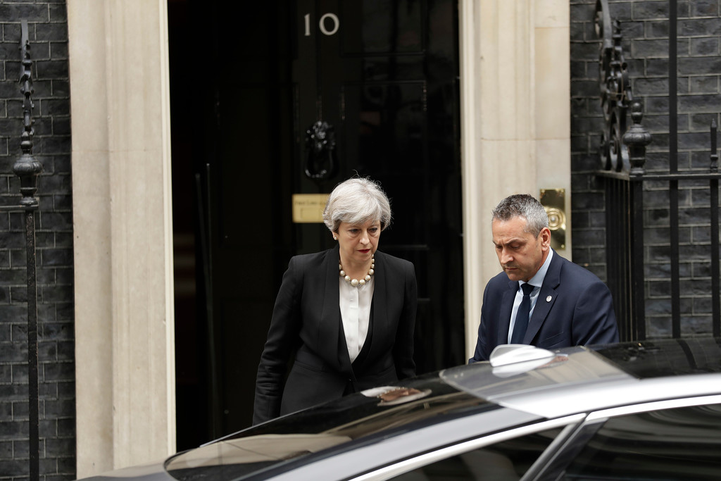 . British Prime Minister Theresa May departs 10 Downing Street, London, to go to Manchester, Tuesday May 23, 2017. The day after an apparent suicide bomber attacked an Ariana Grande concert as it ended Monday night, killing over a dozen of people among a panicked crowd of young concertgoers. (AP Photo/Matt Dunham)