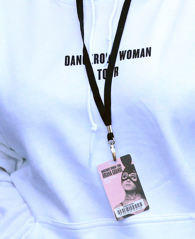 . A badge for Ariana Grande\'s Dangerous Woman Tour is seen on a fan\'s clothes at Manchester Arena in Manchester, England Tuesday May 23 2017.  An apparent suicide bomber attacked her concert as it ended Monday night, killing over a dozen of people among a panicked crowd of young concertgoers, some still wearing the star\'s trademark kitten ears as they fled. (AP Photo/Rui Vieira)